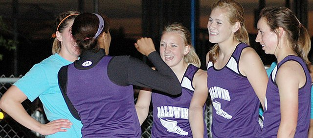 Members of the Baldwin High School girls' track team chat after winning the 1,600-meter relay Thursday night. Pictured from left are senior Julie Hill, senior JaBryanna Wellington, sophomore Elizabeth Sigvaldson, senior Connor Twombly and freshman Kaitlyn Barnes. Both BHS track teams finished runner-up at the Frontier League meet. There will be stories and photos in Thursday's Signal.