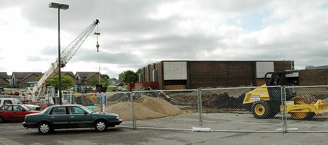 The parking lot and road between Baldwin High School and Baldwin Junior High School are now partially in the construction zone of the new performing arts center. The construction fences were put up nearly three weeks ago.