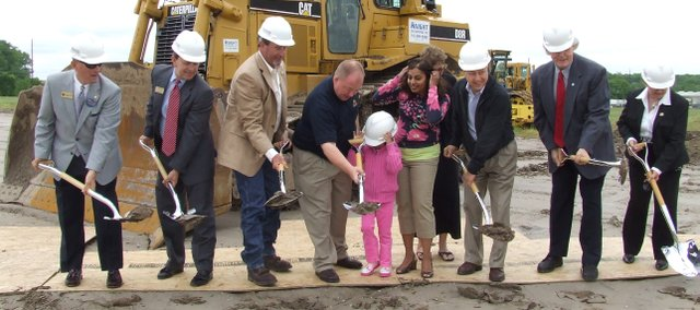 Earp Distribution and state officials break ground Thursday, May 13 at Earp's new site in Edwardsville. Pictured are: (from left) Wyandotte County Commissioner Tom Cooley, Deputy Secretary of the Kansas Department of Commerce Steve Kelly, Chip McGeehan with McDonald's Corp., chairman and owner of Earp Distribution Cliff Earp with daughter Isabella Earp and wife, Caryl Earp, Mary Hewlett, general manager of Earp Distribution Steve Hewlett, Edwardsville Mayor John McTaggart, and Kansas Rep. Margaret Long.