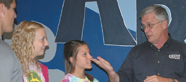 Mill Valley Principal Joe Novak talks with students during school last week. Novak will be retiring after 20 years in the De Soto School District, the last 10 years as principal at MVHS.