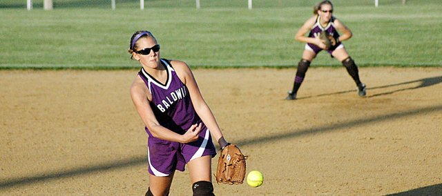 Baldwin High School sophomore Hayley Schwartz pitches Tuesday night as fellow sophomore Alexis Finucane plays second base in the background. The Bulldogs' season ended Tuesday as they lost to Ottawa 13-3.