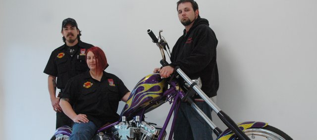 Ben Bruce, left, Danielle Valez, middle, and Andy Moritz recently opened Big Twins motorcycle shop in Edwardsville. The three owners are trained and certified with Harley-Davidson.
