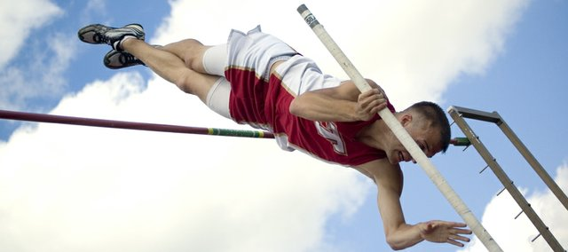Tonganoxie High junior Jake Willis vaults himself to a 14-foot jump — as well as a school record and a regional title — on Friday at THS. Willis' championship was one of four for Tonganoxie athletes at a Class 4A regional held at Beatty Field.