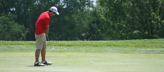 Tonganoxie High golfer Colby Yates rolls a putt toward the hole on May 24 at the Class 4A state golf tournament, played at Hesston Golf Park. Yates finished second with a 75, helping THS take fourth place in the team standings.