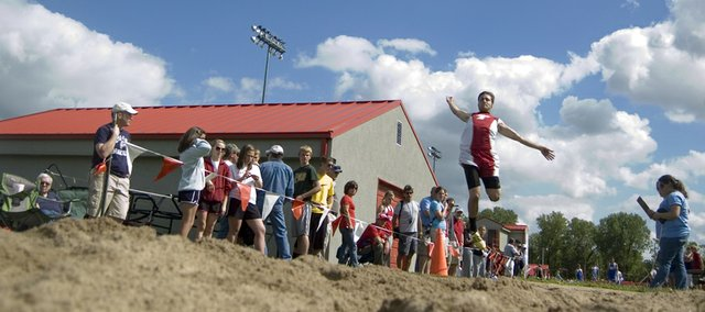 Dylan Scates takes off for a long-jump attempt on Friday at THS. Scates qualified for state in the triple jump.