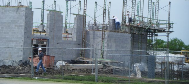 Straub Construction crews work Tuesday on the Basehor-Linwood Health and Wellness Center. USD 458 was granted more than $800,000 from the U.S. Department of Homeland Security to build a storm shelter in the fitness facility, which is expected to open in August.
