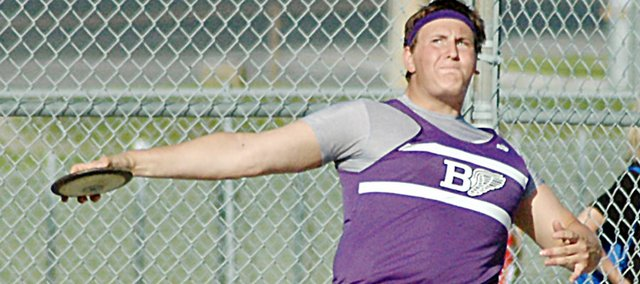 Baldwin High School junior Jesse Austin attempts one of his throws in the discus Friday at the Class 4A regional track and field meet in Tonganoxie. Austin placed second in the discus and the shot put to qualify for the state meet in Wichita this weekend. Fellow thrower, freshman Dayton Valentine, also qualified for both. He placed third in the shot put and fourth in the discus.