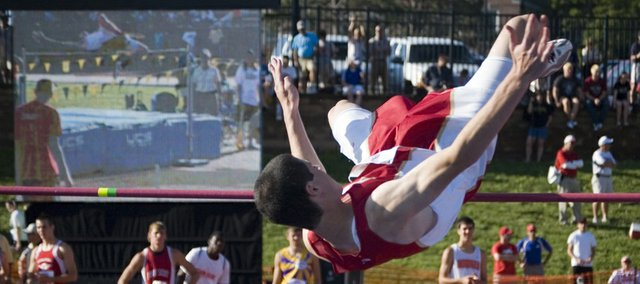 Tonganoxie High sophomore Dylan Jacobs clears the high-jump bar on one of his attempts Friday morning at the state track meet in Wichita as a live feed of his jump is shown on the Cessna Stadium video board. Jacobs medaled, tying for sixth place with a mark of 6-0.