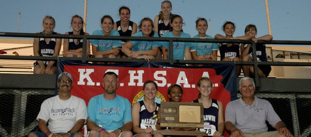 The Baldwin High School girls' track and field team won the Class 4A state championship Saturday night in Wichita. It was the first-ever state title in track for BHS girls' coach Ted Zuzzio, seated far right.