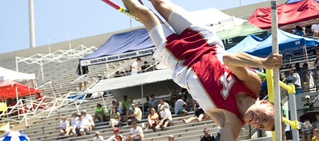 Jake Willis propels himself upward on a state pole vault try Friday at Cessna Stadium. Willis finished fifth in Class 4A with a jump of 13-6.