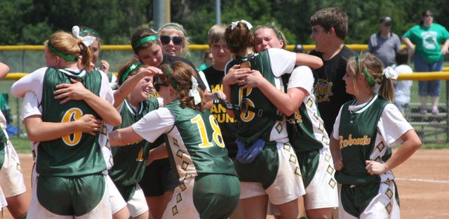 The Basehor-Linwood softball team celebrates on the infield after beating Mulvane, 5-2, to win the Class 4A softball state championship on Saturday in Salina. The Bobcats finished the season with a 24-2 record and won the first state title in a girls sport in school history.