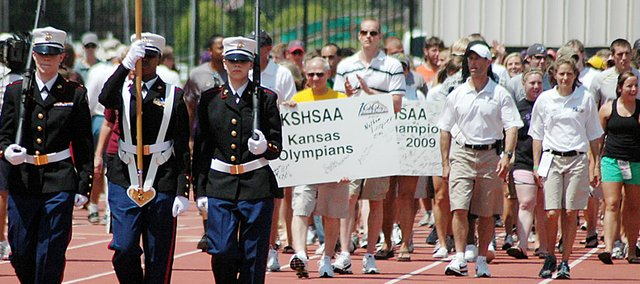 Hundreds of former high school state track and field champions gather on the Cessna Stadium track to begin the parade of champions May 29 at the annual state meet in Wichita.