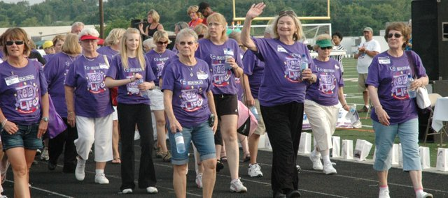 Cancer survivors take the first lap around the track Friday night at the 2010 Kaw Valley Relay for Life.