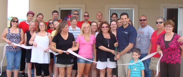 The Basehor Chamber of Commerce joins Pastimes Bar and Grill staff for an official ribbon cutting.