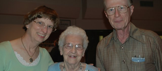 Caroline Camp, middle, celebrates her 90th birthday with her niece Sharon Senger and Sharon's husband, Phil. The Sengers were two of about 90 guests who attended Camp's party at St. Francis de Sales Church in Lansing.