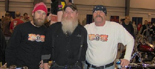 Simon Gallagher, left, attends a motorcycle rally with Midwest Motors mechanic Chris Mellott, middle, and Midwest Motors owner Greg Woolard. Gallagher, Woolard's business partner, was recently injured during an accident Memorial Day weekend.