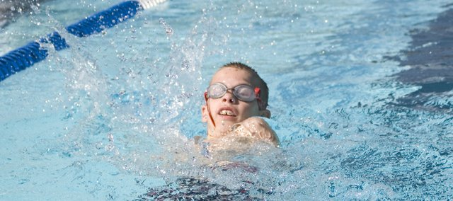 Holden DeGraff of the Tongie Tidal Waves competes in the boys 10 and under backstroke race Wednesday morning at Tonganoxie Water Park. DeGraff won that race as well as the breaststroke in his division.