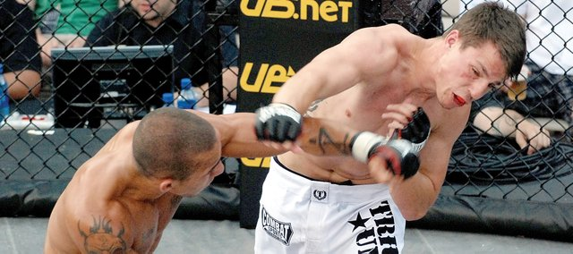 Chad Vandenberg, right, has a punch blocked by his opponent during a mixed martial arts bout at the Bellator Fighting Championships Thursday at the Power and Light District in Kansas City, Mo. A Bonner Springs native, Vandenberg is one of numerous young men in Kansas City giving MMA a try.