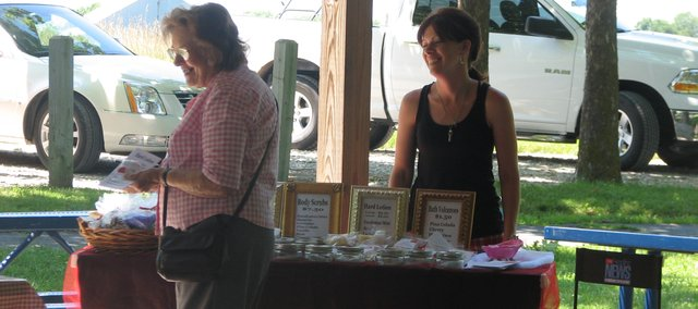 Residents peruse the offerings at the Basehor farmer's market. The market had its first run Sunday, June 20.