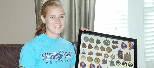 Connor Twombly, a 2010 Baldwin High School graduate, was selected as the Baldwin City Signal's first-ever female senior athlete of the year. Twombly collected dozens of medals from cross country and track during her four years. Included in her winnings are seven state championships.