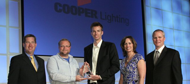 Matthew Johnson, center in sportscoat, is awarded a crystal trophy in recognition of his first-place win in the 2010 Cooper Lighting SOURCE Awards National Lighting Design Competition. Johnson, Shawnee, recently received a master's degree from Kansas State University. Pictured is Lance Bennett, Cooper Lighting vice president of specification sales, left, Will Yankey, KSU assistant professor, Matt Johnson, Rebecca Hadley-Catter, manager of SOURCE (Cooper Lighting's education center), and Kraig Kasler, Cooper Lighting's vice president of marketing.