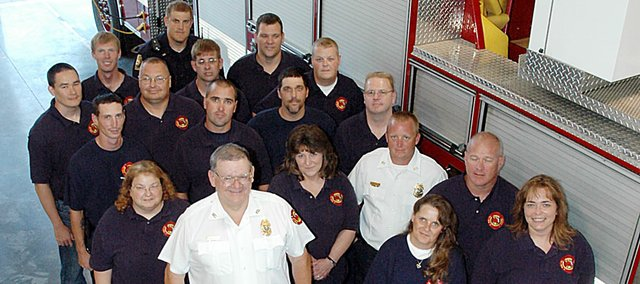 Fire Chief Allen Craig, front and center, and the members of the Baldwin City Volunteer Fire Department celebrated 100 years of serving the city at an open house Sunday. There was a good crowd on hand at the ceremony, including numerous city officials, former fire fighters and family members.