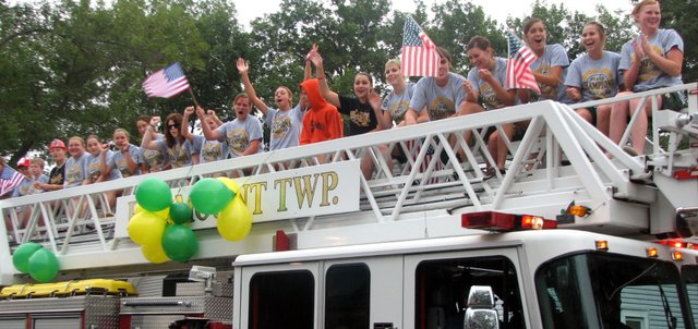 The Basehor-Linwood High School softball team hitches a ride on a Fairmount Township fire engine during the 2010 July 4 parade. The team was featured in the parade as the 2010 4A state champions.