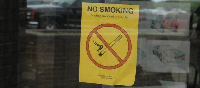 "A ""no smoking"" sign hangs outside Kobi's Bar and Grill in Bonner Springs. The statewide smoking ban went into effect July 1."