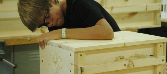 Thomas Hook, 14, works diligently to help build infant caskets as a community service project at Bonner Springs High School. The idea for the volunteer project came from Bonner Springs High School teacher Kris Munsch.