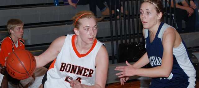 Lynsey Ostman, left, was a four-year varsity basketball player at Bonner Springs High School. Throughout her career she earned a reputation for her hustle and toughness.