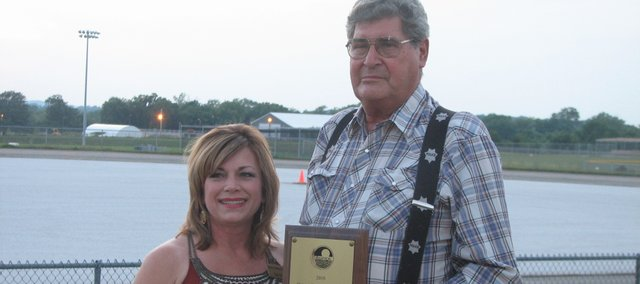 "Don ""Slim"" Wilson accepts the Basehor Citizen of the Year award Saturday from Chamber Vice President Deb Taylor."