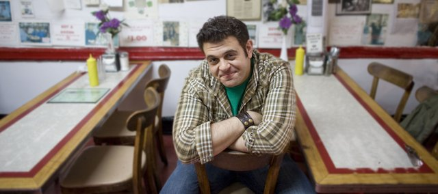 "Adam Richman, host of the Travel Channel's ""Man v. Food"" show, recently came to Bonner Springs to try to conquer the food challenge at Papa Bob's BBQ. The show follows Richman as he takes on eating challenges throughout the country."