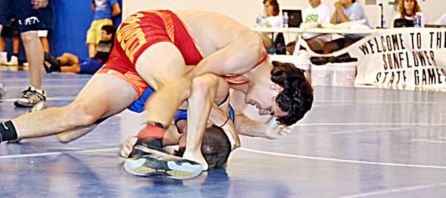 Baldwin High School senior Will Von Bargen, top, went 2-1 Saturday to finish second in his weight class at the Sunflower State Games. Von Bargen was one of nine Baldwin City wrestlers to medal Saturday.