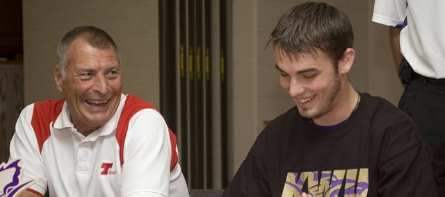 Keaton Schaffer, right, and his grandfather, Dave McKee, laugh as Schaffer signs a letter of intent to play basketball at Kansas Wesleyan University on May 11.