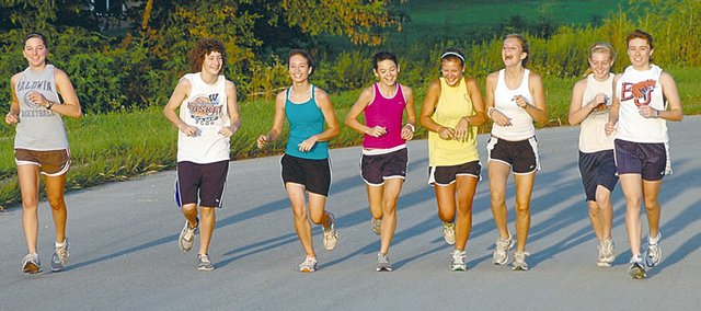 A handful of Baldwin High School cross country runners share a laugh while jogging Friday morning. From left are BHS 2010 graduate Julie Hill, freshman Katie Jones, freshman Leyana Watson, freshman Hannah Hutton, freshman Ashton Temple, eighth grader Molly Ogden, freshman Libby Verhaeghe and senior Heather Karlin.