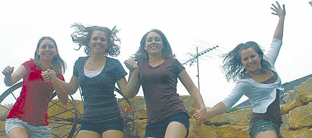The Krysztof girls jumped off a rock ledge at their rural Baldwin City home just for the fun of it. They are, from left, Katie, Michaela, Emily and Brianna. The foursome has been active in 4-H and the Douglas County Fair for many years.