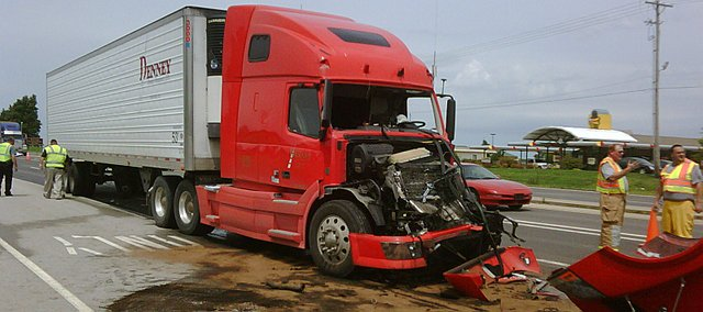 One man was taken to the hospital after his semi-truck plowed into another in Basehor.