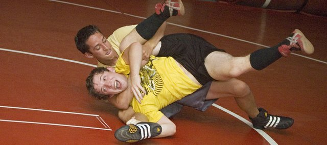 Tonganoxie High wrestler Caleb Himpel pulls down teammate Justin Soetaert as the two square off at an open room session on Tuesday, July 20. The Chieftains had the opportunity to work with each other at open room twice a week this summer.