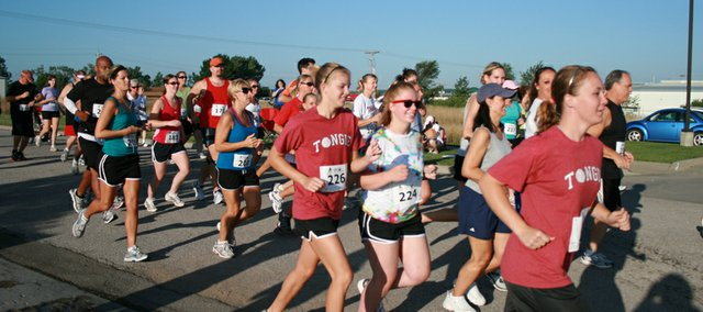Runners compete in the Small Town Big Cause 5K Run/Walk on Saturday in Tonganoxie. Roughly 100 runners participated in the event, while 30 volunteers helped with the race. Money went to the Lawrence Memorial Hospital Endowment Association.