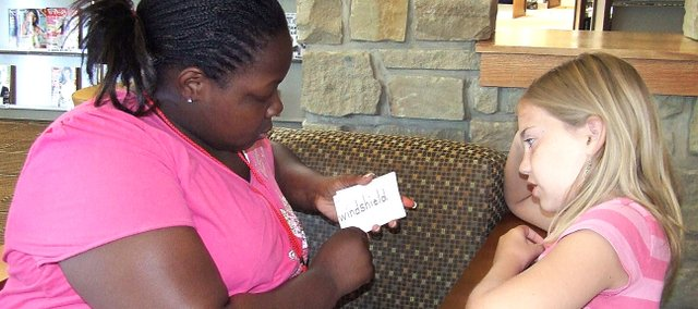 DaNa'e Banks, left, helps Kathy Cleveland recognize sight words using flash cards on the last day of a new summer tutoring program started by Lorna Carter-Sims and Teresa Bolton.