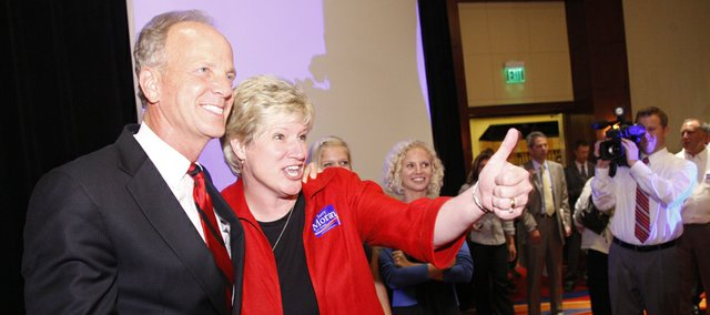 U.S. Rep. Jerry Moran, of Hays, stands next to his wife, Robba, on Tuesday as she gives a thumbs up to his supporters after it was announced that he had won the Republican nomination for the U.S. Senate seat. The Morans were at a watch party organized by the Johnson County Republican Party at the Overland Park Marriott.