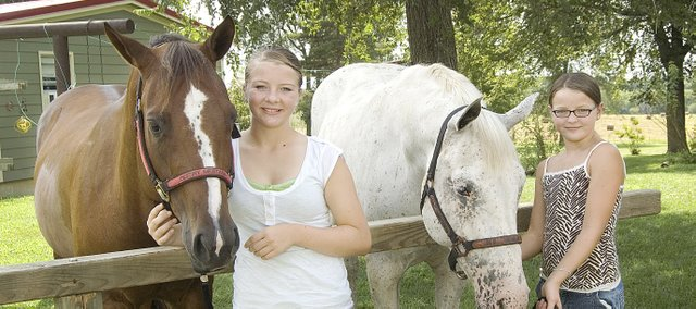Sisters Destiny (left)  and Mable Mestagh, rural McLouth, are involved in several projects in 4-H, but they're most involved in horses, which they will be showing Monday at the Leavenworth County Fair in Tonganoxie.