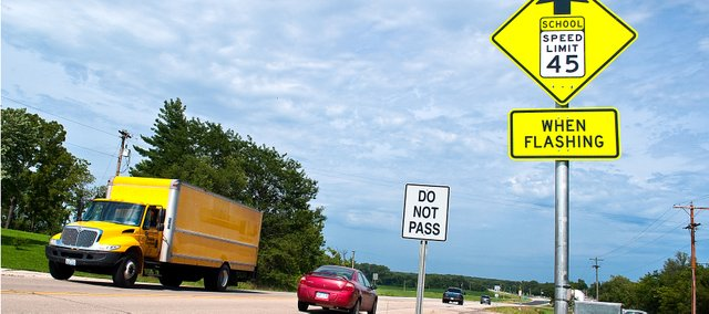 The Kansas Department of Transportation recently installed new traffic signals on the east and westbound lanes of Kansas Highway 32 near Linwood to slow down traffic near the school.
