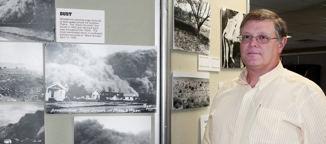 "Tony Kramer, owner of Kramer and Associates, CPAs, L.L.C., is the sponsore of the Basehor museum's newest exhibit, ""Dust Bowl in Kansas."" The exhibit of photographs will be on display through the remainder of August."
