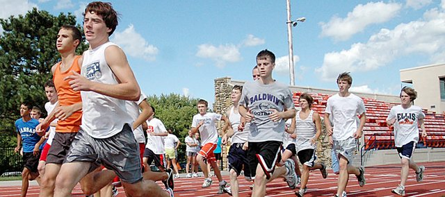 Baldwin High School and Baldwin Junior High School fall sports' practices start Monday. Here the BHS boys' cross country team runs a workout at Liston Stadium last fall.
