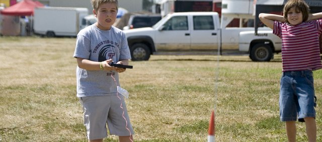 Emmett Keene watches with anticipation a moment before his rocket launches Friday at the Leavenworth County Fair. Keene, of Happy Helpers 4-H Club, won a purple ribbon for his rocket at the fair.