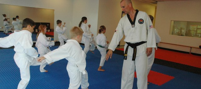 Taekwondo instructor Rick Grimm (right) teaches a class at his new studio, Grand Master Kim's Taekwondo, in Bonner Springs.