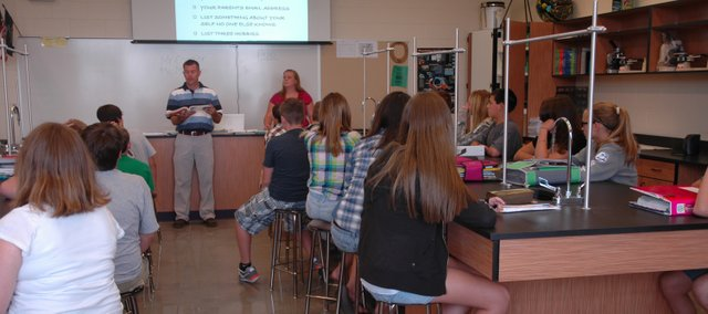 Basehor-Linwood Middle School students listen to their teacher in one of the new schools science labs. The classrooms are just one of the features the new building has to offer its students. 