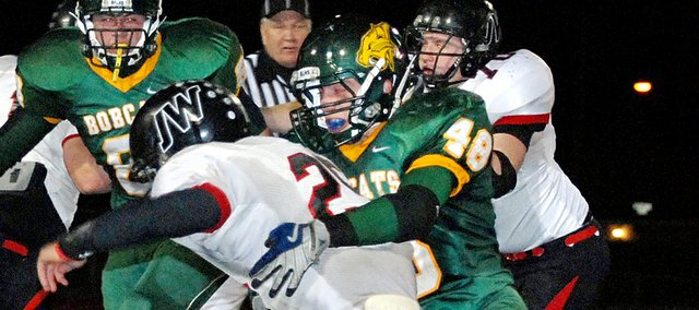 Chandler King, Basehor-Linwood linebacker, makes a tackle during the Bobcats playoff game against Jefferson County West last season. King is one of just a handful of returning starters for the Bobcats this season.