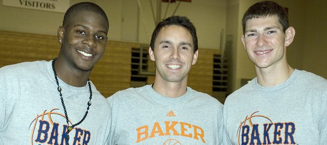 New Baker University men's basketball coach Brett Ballard, center, was joined by Jayhawk basketball players Josh Selby and Tyrel Reed during summer camp at the Collins Center.